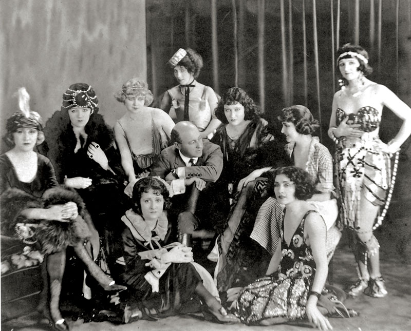 DeMille on the set of The Affairs of Anatol (1921) with, among others, the future stars Bebe Daniels and Gloria Swanson